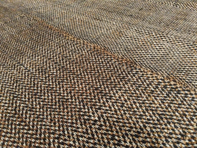 A stunning wool Kilim handwoven in the style of the antique tribal flat-weaves, distinguished by a careful miscellany of hand-spun wool threads in chocolate brown, camel and ivory, creating a highly elegant tweed-like zig-zag pattern. The central