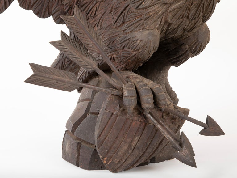 Outstanding Large Oak Carved Eagle Grasping Shield & Three Arrows For Sale 4