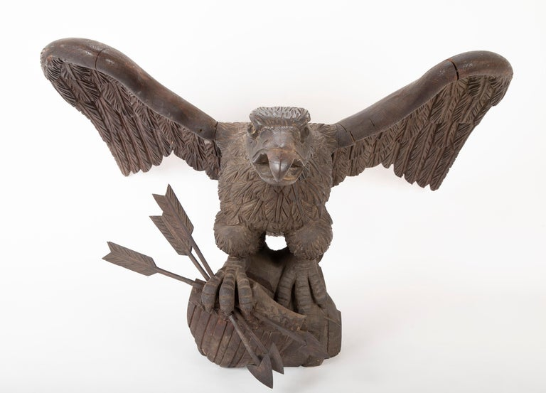 Outstanding large oak carved eagle grasping shield with three arrows in his talons; most probably by a Philadelphia carver. Found in East Boothbay, Maine at collector's home. Arrows have been repaired.
