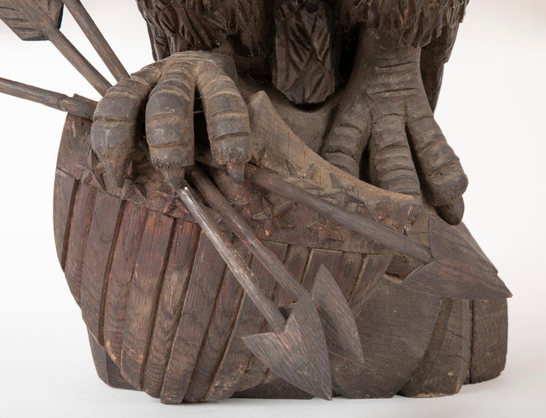 Outstanding Large Oak Carved Eagle Grasping Shield & Three Arrows For Sale 1
