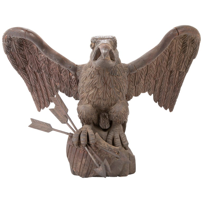 Outstanding Large Oak Carved Eagle Grasping Shield & Three Arrows For Sale