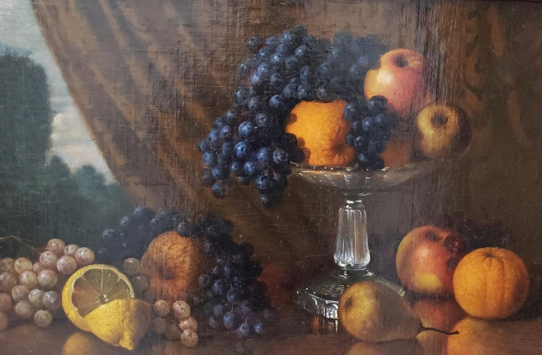 Late 19th century still life with fruit oil painting circa 1880  A superb original oil painting of a table overflowing with fruit. A cut lemon, orange, apple, grapes and a pear all displayed on a table in front of a draped window.  The painting