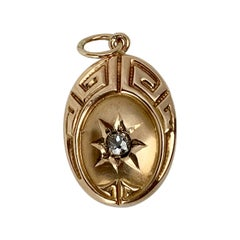 Greek Key Motif with Diamond-Oval 10 Karat Yellow Gold Pendant