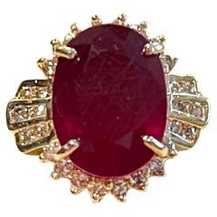 Oval 12 Carat Treated Ruby and 1 Carat Diamond 14 Karat Yellow Gold Ring