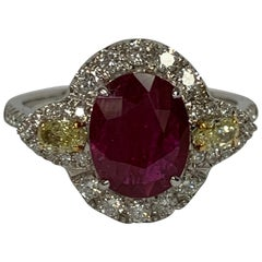 Oval 1.66 Carat Ruby and Diamond Ring