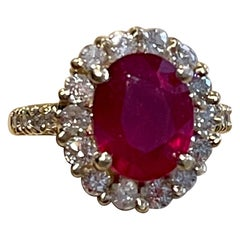 Oval 5 Carat Treated Ruby and 1.25 Carat Diamond 14 Karat Yellow Gold Ring