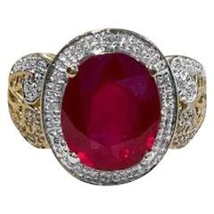 Oval 7.5 Carat Treated Ruby and 1 Carat Diamond 14 Karat Yellow Gold Ring