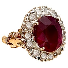 Oval 8 Carat Treated Ruby and 1 Carat Diamond 14 Karat Two Tone Gold Ring
