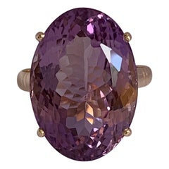 Oval Amethysts Set in 14 Karat Yellow Gold Ring