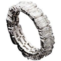 Oval and Emerald Diamond Illusion Eternity Ring in 18 Karat Gold