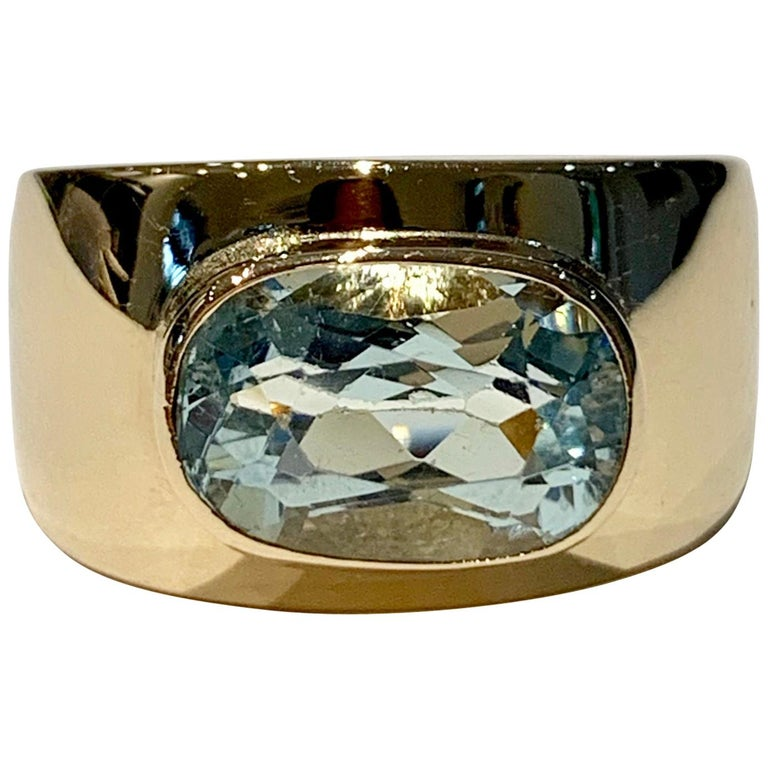 Oval Aquamarine in Wide 9 Carat Yellow Gold Band For Sale