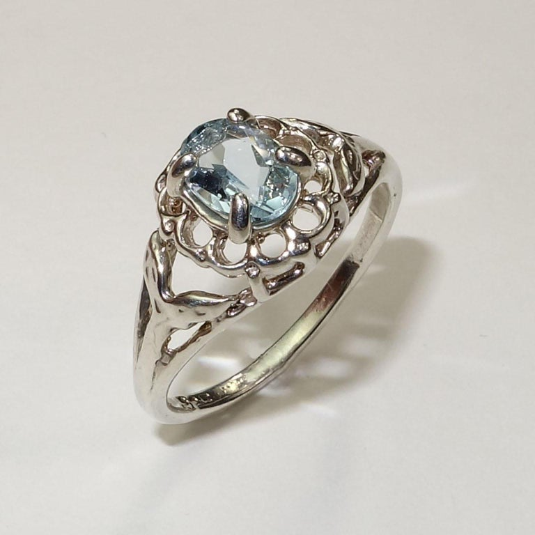 Custom made, Beautiful Blue oval Aquamarine set in Sterling Silver ring. . Delicate blue Aquamarine matches the unique filigree of the ring.  Remember that Aquamarine is  the March birthstone.  Sizable by your jeweler, 6.5. To see more from this