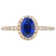 Oval Blue Sapphire and Diamond Halo Ring in 14 Karat Rose Gold