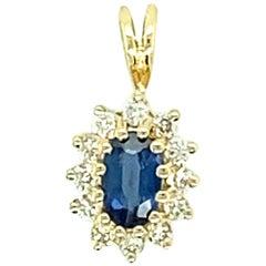 Oval Blue Sapphire and Diamond Pendant