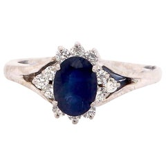 Oval Blue Sapphire Halo Engagement Ring