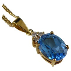 Oval Blue Topaz and Diamond Pendant on Chain, Yellow Gold