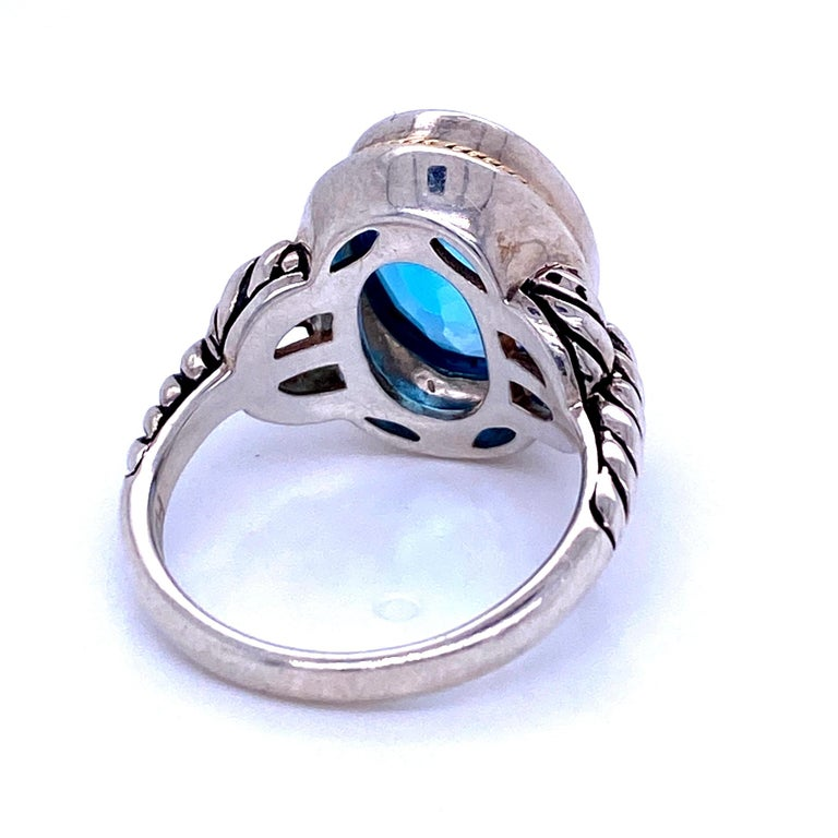 Contemporary Oval Blue Topaz Ring