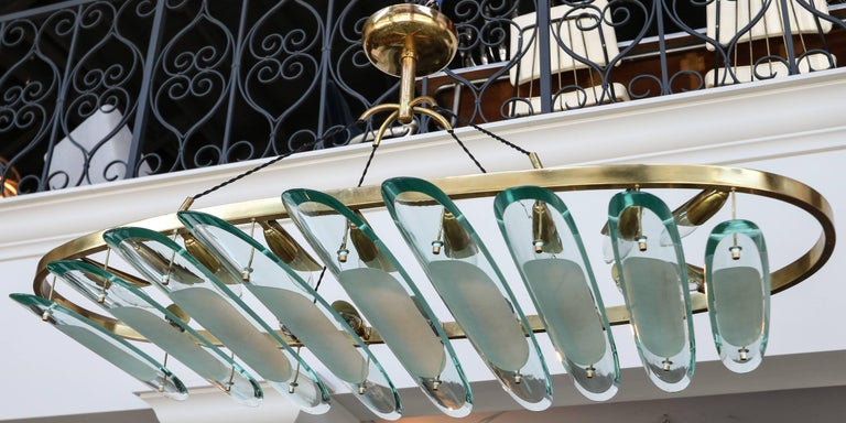 Brass oval chandelier by Fontana Arte for Dominici with clear and sanded glass pieces.