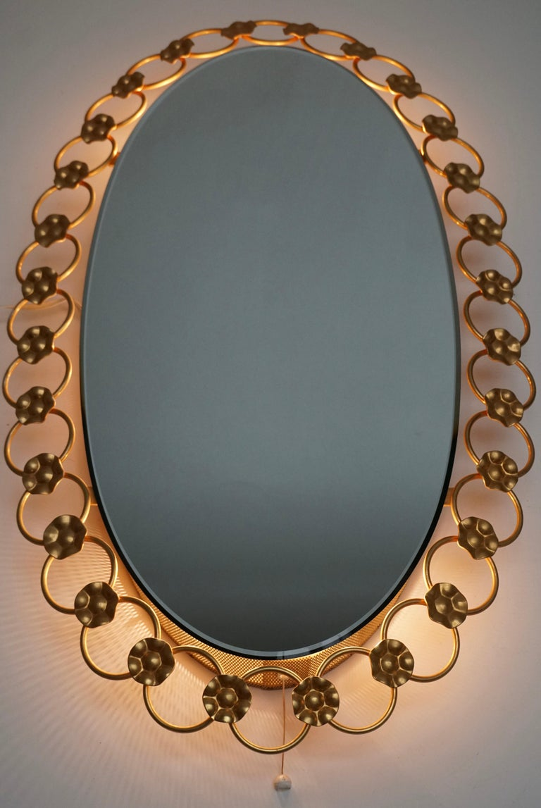German oval mirror with light, Italy, 1950s.