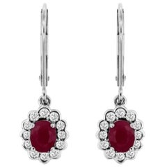 Oval Brilliant Cut Ruby and Round Diamond Drop Style Earrings in 14 Karat Gold