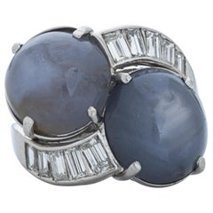 Oval Cabochon Star Sapphire and Baguette Diamond Bypass Ring in Platinum