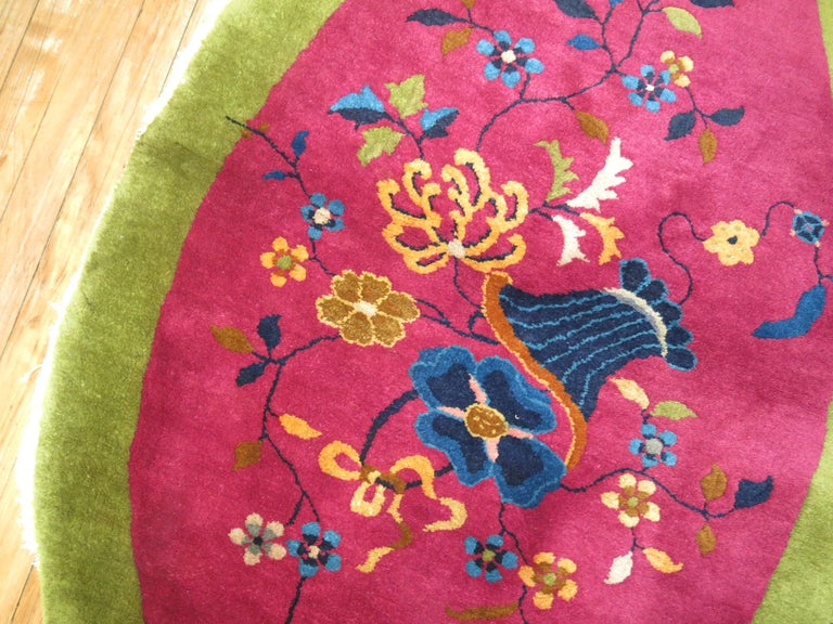 Rare oval shaped Chinese Art Deco rug.  Chinese Art Deco rugs are known for their striking mix of asymmetrical patterns, vibrant colors, and traditional motifs, which are is bold, beautiful, and quite rare. Woven between World War I and World War