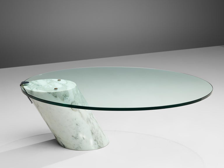 Team Form AG for Ronald Schmitt, coffee table model 'K1000', marble, glass, Switzerland, 1970s   This cocktail table is made out of a solid Carrara marble base with a clear glass top. The oval top is attached to the slanted cylindrical base, just