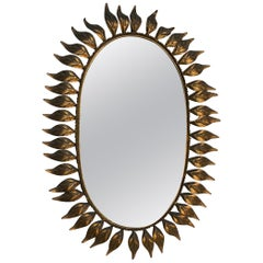Oval Gilt Metal Sunburst Mirror with Leaves
