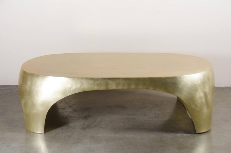 Oval Curve Cocktail Table Brass Hand Repoussé Limited Edition In Stock  Repoussé is the traditional art of hand-hammering decorative relief onto sheet metal. The technique originated around 800 BC between Asia and Europe and in Chinese historical
