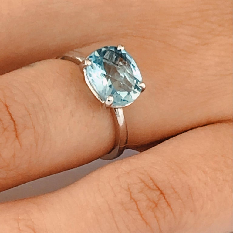 Contemporary Cushion Aquamarine Prong Set in 18 Karat White Gold Fashion Ring For Sale