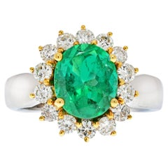 Oval Cut, 3 Carat Colombian Emerald and Diamond Halo 18K White Gold Ring