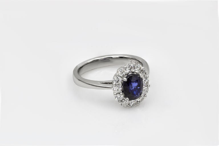 Oval Cut Blue Sapphire and Diamond Halo Engagement Ring In New Condition For Sale In New York, NY