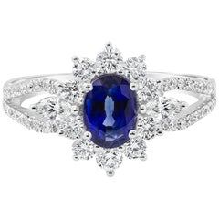 Roman Malakov, Oval Cut Blue Sapphire and Diamond Halo Engagement Ring