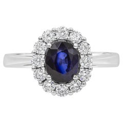 Oval Cut Blue Sapphire and Diamond Halo Engagement Ring