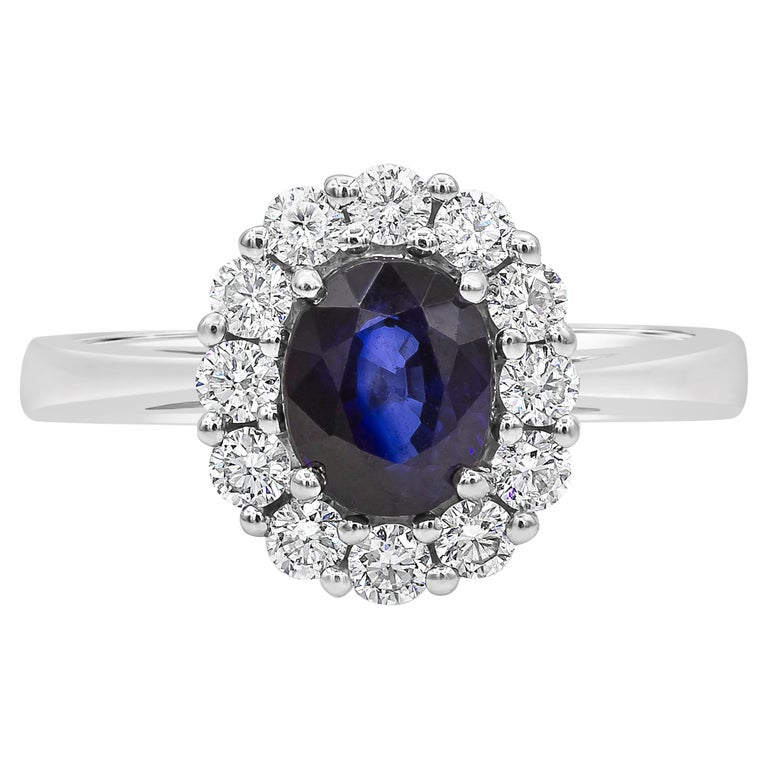 Oval Cut Blue Sapphire and Diamond Halo Engagement Ring For Sale