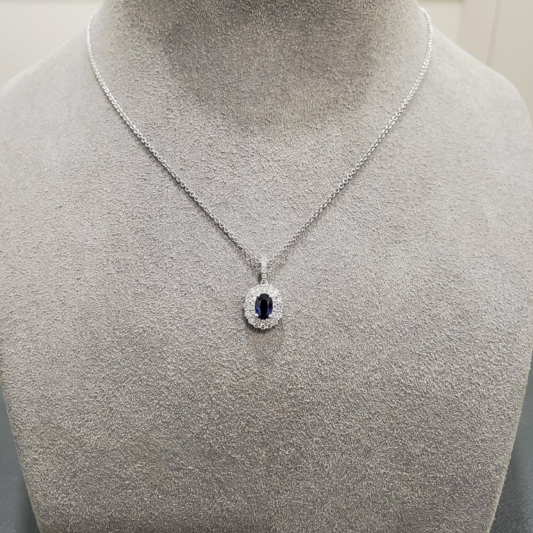 Contemporary Oval Cut Blue Sapphire and Halo Pendant Necklace For Sale