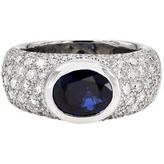 Oval Cut Blue Sapphire and Round Diamond Ring in Platinum