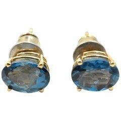 Oval Cut Blue Topaz Stud Earrings 14 Karat Yellow Gold