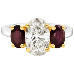 Oval Cut Diamond and Ruby Three-Stone Engagement Ring