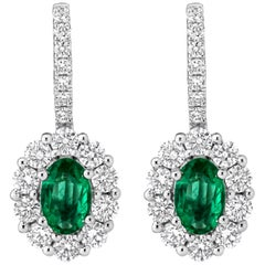 Oval Cut Emerald and Diamond Halo Lever-Back Earrings