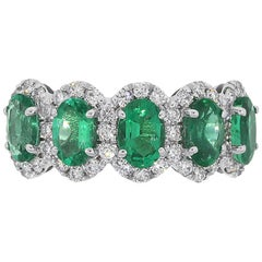 Oval Cut Emerald and Diamond Ladies Band Ring