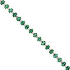 Oval Cut Emerald and Round Diamond Bracelet