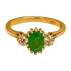 Oval Cut Emerald & Diamond Ring in 18 Karat Yellow Gold