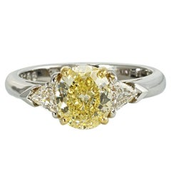 Oval Cut Fancy Yellow Three-Stone Diamond Engagement Platinum Ring