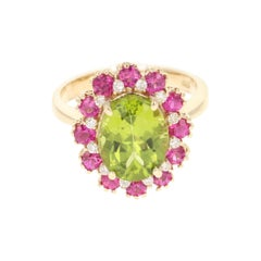 4.56 Carat Oval Cut Peridot Pink Sapphire Diamond 14 Karat Yellow Gold Ring