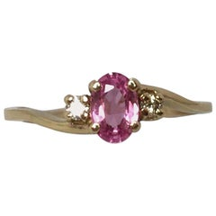 Oval Cut Pink Sapphire and Diamond 3-Stone Yellow Gold Three-Stone Ring