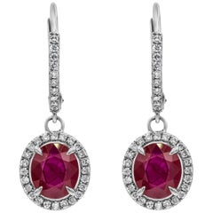 Oval Cut Ruby and Diamond Halo Dangle Earrings