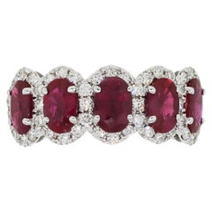 Oval Cut Ruby and Diamond Halo Ring
