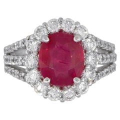 Oval Cut Ruby Ring with Diamonds