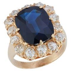 Oval Cut Sapphire & Diamond Halo Ring